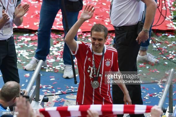 Bayern Munich's German defender Philipp Lahm waves after the German first division Bundesliga football match FC Bayern Munich vs SC Freiburg his last...