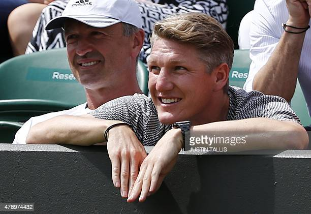 Bayern Munich's German footballer Bastian Schweinsteiger watches his partner Serbia's Ana Ivanovic play against China's YiFan Xu during their women's...