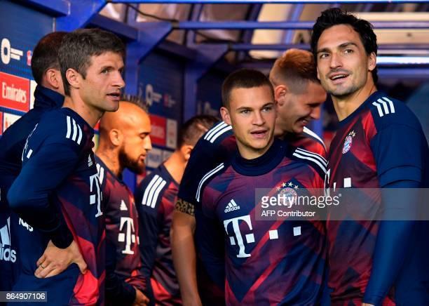 Bayern Munich's German forward Thomas Mueller Bayern Munich's German midfielder Joshua Kimmich and Bayern Munich's German defender Mats Hummels wait...