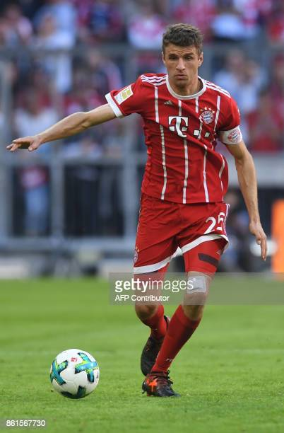 Bayern Munich's German forward Thomas Mueller plays the ball during the German First division Bundesliga football match FC Bayern Munich vs SC...