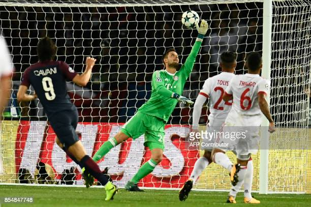 Bayern Munich's German goalkeeper Sven Ulreich dives in vain and Paris SaintGermain's Uruguayan forward Edinson Cavani scores a goal during the UEFA...