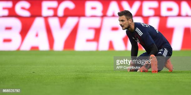 Bayern Munich's German goalkeeper Sven Ulreich stretches as he warms up prior to the German first division Bundesliga football match Bayern Munich vs...