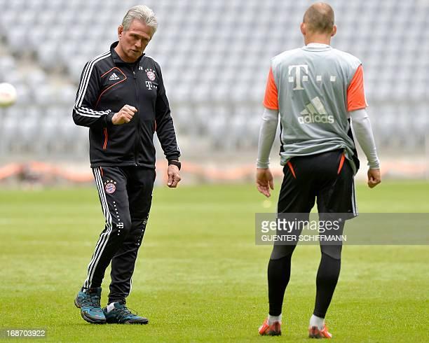 Bayern Munich's German head coach Jupp Heynckes talks to Bayern Munich's Dutch midfielder Arjen Robben during a training session at the Allianz Arena...