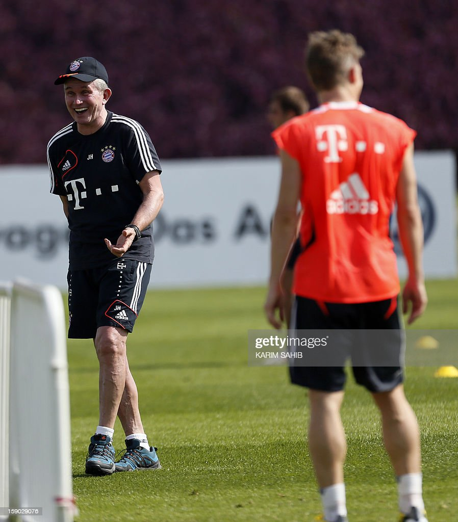 Bayern Munich's German Manager Jupp Heynckes (L) attends a training session at the Aspire Academy for Sports Excellence in Doha on January 6, 2013. Bayern Munich is in Qatar for a week-long training camp before the beginning of the new season of the German Bundesliga after the winter break. AFP PHOTO/KARIM SAHIB