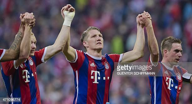 Bayern Munich's German midfielder Bastian Schweinsteiger and Bayern Munich's German defender Philipp Lahm celebrate after the German first division...