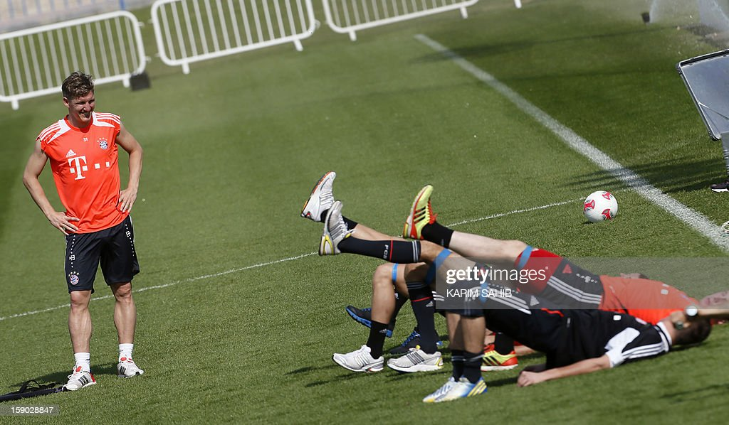 Bayern Munich's German midfielder Bastian Schweinsteiger (L) attends a training session at the Aspire Academy for Sports Excellence in Doha on January 6, 2013. Bayern Munich is in Qatar for a week-long training camp before the beginning of the new season of the German Bundesliga after the winter break.