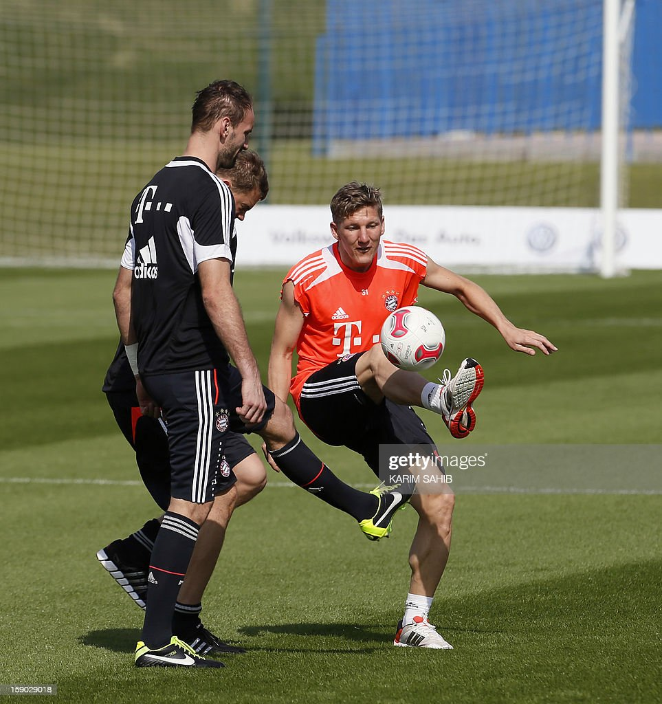 Bayern Munich's German midfielder Bastian Schweinsteiger (R) attends a training session at the Aspire Academy for Sports Excellence in Doha on January 6, 2013. Bayern Munich is in Qatar for a week-long training camp before the beginning of the new season of the German Bundesliga after the winter break. AFP PHOTO/KARIM SAHIB