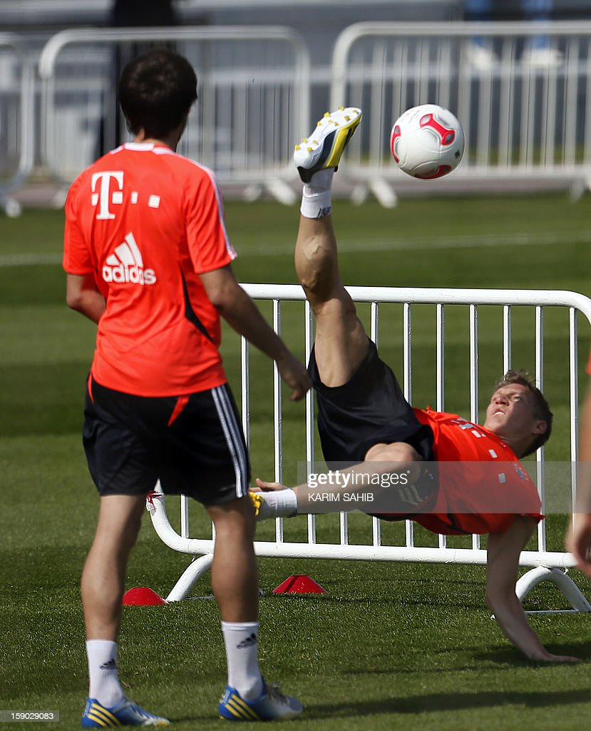 Bayern Munich's German midfielder Bastian Schweinsteiger (back) attends a training session at the Aspire Academy for Sports Excellence in Doha on January 6, 2013. Bayern Munich is in Qatar for a week-long training camp before the beginning of the new season of the German Bundesliga after the winter break.