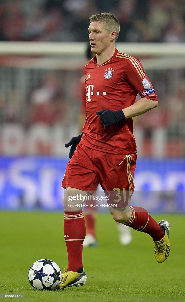 Bayern Munich's German midfielder Bastian Schweinsteiger plays the ball during the UEFA Champions League quarter final match between FC Bayern Munich vs Juventus Turin at the Allianz Arena stadium in Munich, southern Germany, on April 2, 2013.