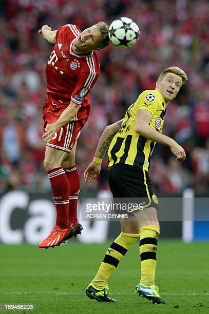 Bayern Munich's German midfielder Bastian Schweinsteiger vies withBorussia Dortmund's German midfielder Marco Reus during the UEFA Champions League...