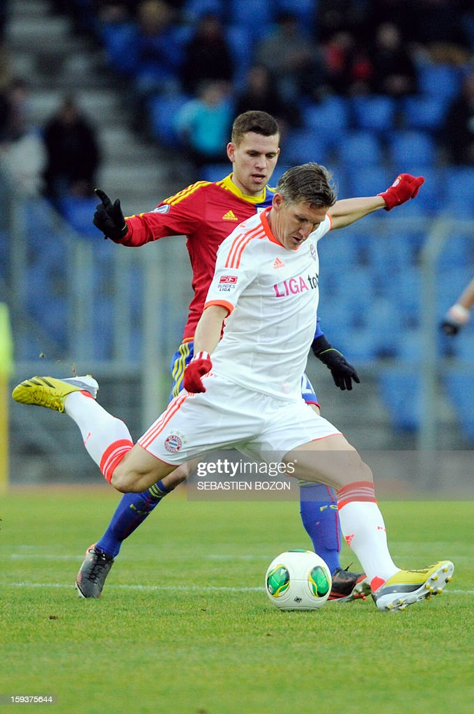 Bayern Munich's German midfielder Bastian Schweinsteiger (C) vies with Basel's Swiss midfielder Fabian Frei (L) during a friendly football match betwwn Basel (FCB) and Bayern Munich (FCBM) in Basel on January 12, 2013.