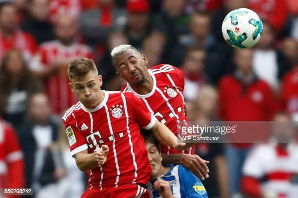 Bayern Munich's German midfielder Joshua Kimmich and Bayern Munich's German defender Jerome Boateng vie for the ball with Berlin's Japanese...