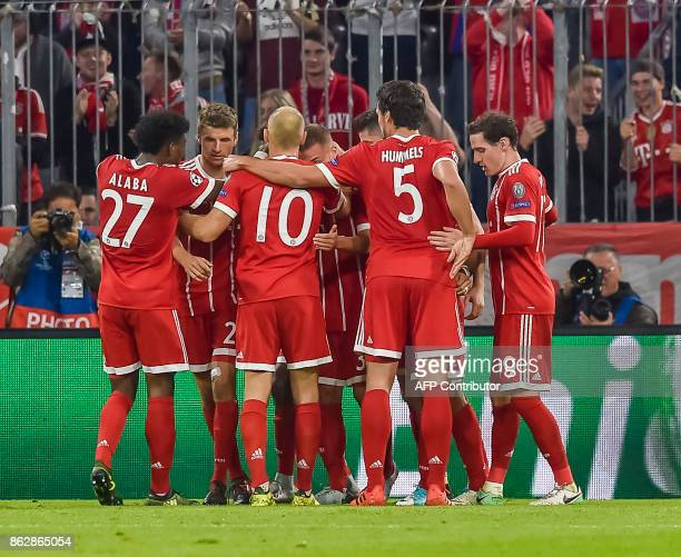 Bayern Munich's German midfielder Joshua Kimmich celebrates scoring with his teammates during the Champions League group B match between FC Bayern...