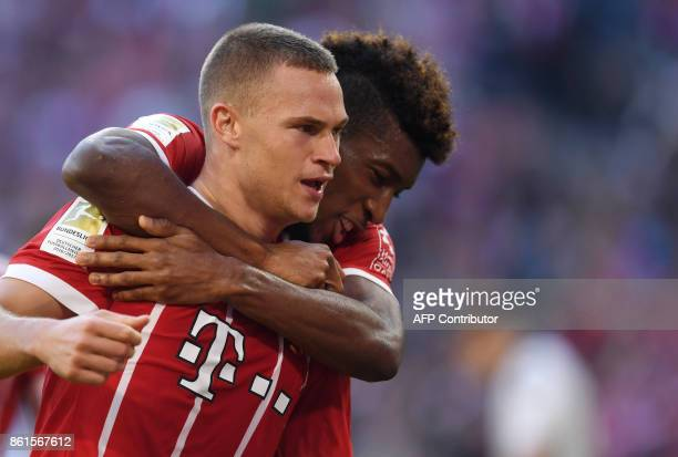 Bayern Munich's German midfielder Joshua Kimmich celebrates with Bayern Munich's French forward Kingsley Coman after a goal during the German First...