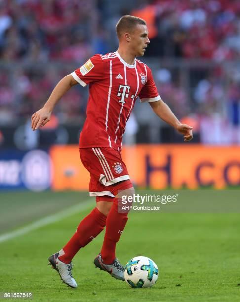 Bayern Munich's German midfielder Joshua Kimmich plays the ball during the German First division Bundesliga football match FC Bayern Munich vs SC...