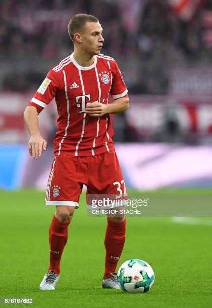 Bayern Munich's German midfielder Joshua Kimmich plays the ball during the German First division Bundesliga football match Bayern Munich vs FC...
