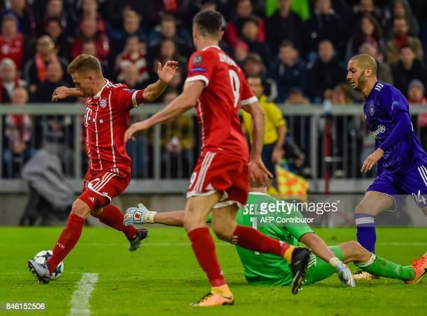 Bayern Munich's German midfielder Joshua Kimmich scores the third goal past Anderlecht's Belgian goalkeeper Matz Sels during the Champions League...