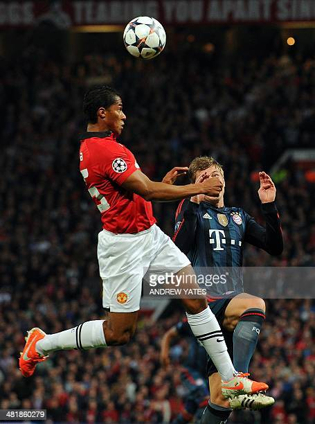 Bayern Munich's German midfielder Toni Kroos challenges Manchester United's Ecuadorian midfielder Antonio Valencia during the UEFA Champions League...