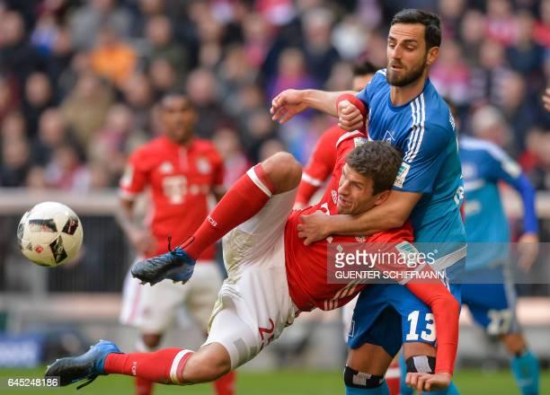 Bayern Munich's German striker Thomas Mueller and Hamburg's Albanian defender Mergim Mavraj vie for the ballduring the German first division...