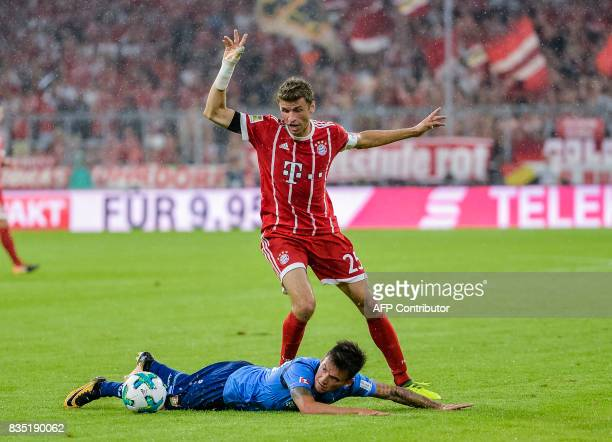 Bayern Munich's German striker Thomas Mueller and Leverkusen's Chilian midfielder Charles Aranguiz vie for the ball during the German First division...