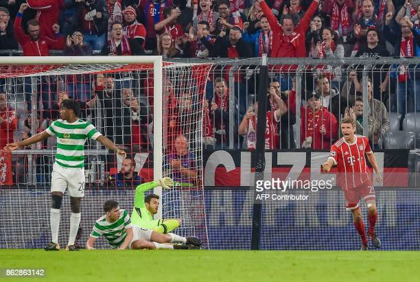 Bayern Munich's German striker Thomas Mueller celebrates scoring the opening goal during the Champions League group B match between FC Bayern Munich...