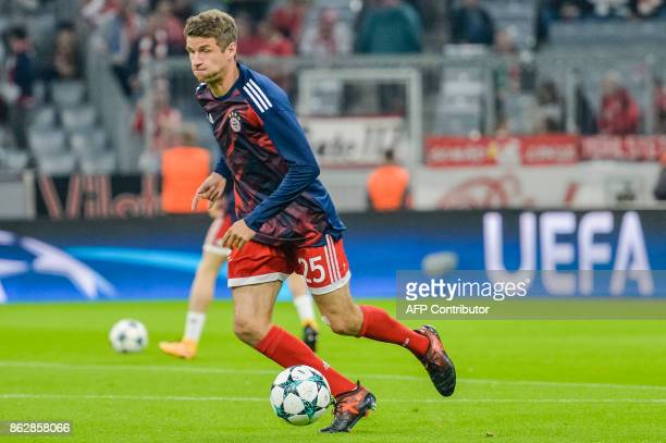 Bayern Munich's German striker Thomas Mueller warms up prior to the UEFA Champions League Group B match between FC Bayern Munich vs Celtic Glasgow at...