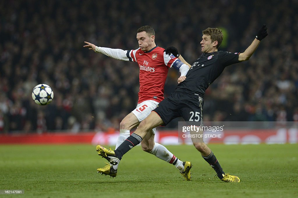 Bayern Munich's German striker Thomas Muller (R) challenges Arsenal's Belgian defender Thomas Vermaelen (L) during the UEFA Champions League round of 16 football match between Arsenal and Bayern Munich at the Emirates Stadium in north London on February 19, 2013. Bayern Munich won 3-1.