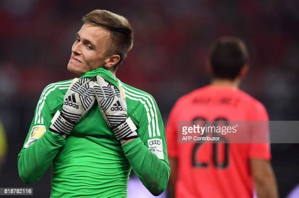 Bayern Munich's goalkeeper Christian Fruechtl reacts during the penalty shoot out during the International Champions Cup football match between...