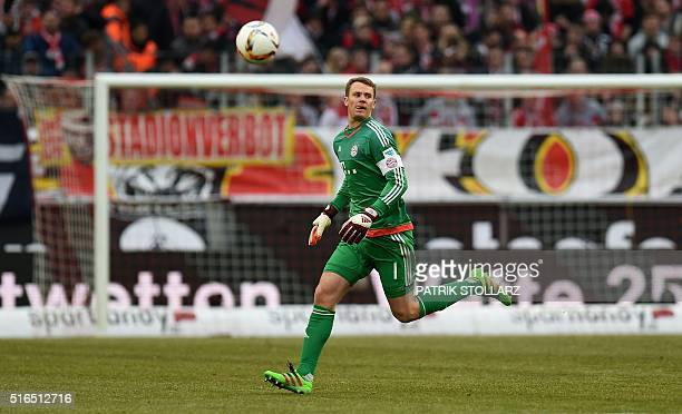 Bayern Munich's goalkeeper Manuel Neuer plays the ball during the German Bundesliga first division football match between FC Cologne vs FC Bayern...