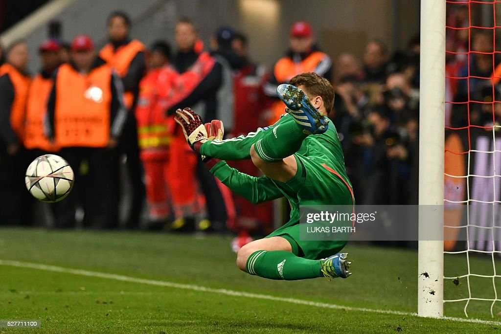 Bayern Munich's goalkeeper Manuel Neuer saves a penalty during the UEFA Champions League semi-final, second-leg football match between FC Bayern Munich and Atletico Madrid in Munich, southern Germany, on May 3, 2016. / AFP / LUKAS