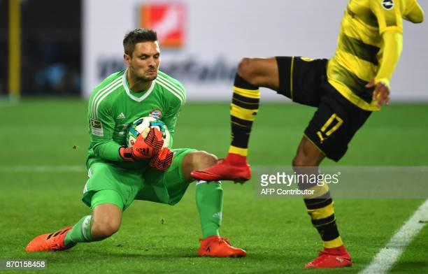 Bayern Munich´s goalkeeper Sven Ulreich tries to catch the ball during the German First division Bundesliga football match Borussia Dortmund vs...