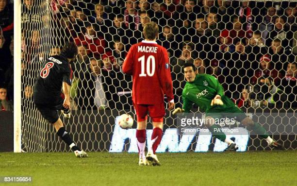 Bayern Munich's Hamit Altintop hits his penalty during the UEFA Cup match at the Pittodrie Stadium Aberdeen