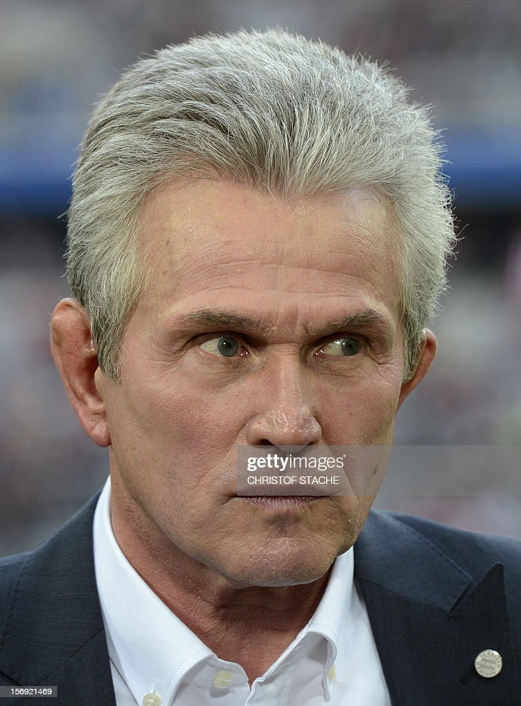 Bayern Munich's head coach Jupp Heynckes looks on ahead of the German first division Bundesliga football match FC Bayern Munich vs Hanover 96 in Munich, southern Germany, on November 24, 2012. Bayern Munich won the match 5-0. AFP PHOTO / CHRISTOF STACHE