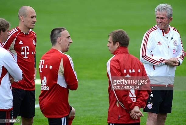 Bayern Munich's head coach Jupp Heynckes stands next to Bayern Munich's Dutch midfielder Arjen Robben French midfielder Franck Ribery and defender...