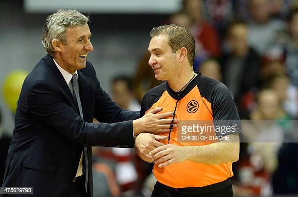 Bayern Munich's head coach Svetislav Pesic jokes with the referee during the Euroleague Top 16 Basketball match FC Bayern Basketball vs Zalgiris...