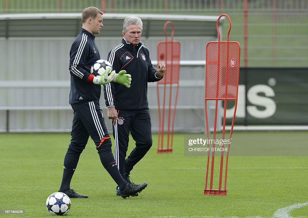 Bayern Munich's headcoach Jupp Heynckes (R) and Bayern Munich's goalkeeper Manuel Neuer talk during the final team training on the eve of the UEFA Champions League semi final first leg football match between FC Bayern Munich and FC Barcelona at the trainings area in Munich, southern Germany, on April 22, 2013. The semi final match will take place on April 23, 2013.
