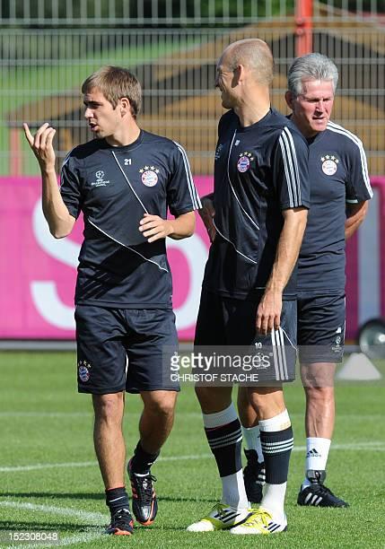 Bayern Munich's headcoach Jupp Heynckes Bayern Munich's Dutch midfielder Arjen Robben and Bayern Munich's defender Philipp Lahm take part in a...