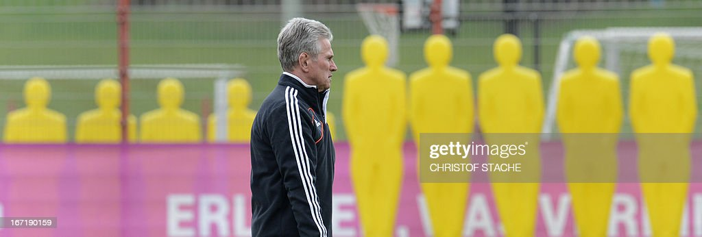 Bayern Munich's headcoach Jupp Heynckes follows the final team training ahead the UEFA Champions League semi final first leg football match between FC Bayern Munich and FC Barcelona at the trainings area in Munich, southern Germany, on April 22, 2013. The semi final match will take place on Tuesday evening, April 23, 2013.