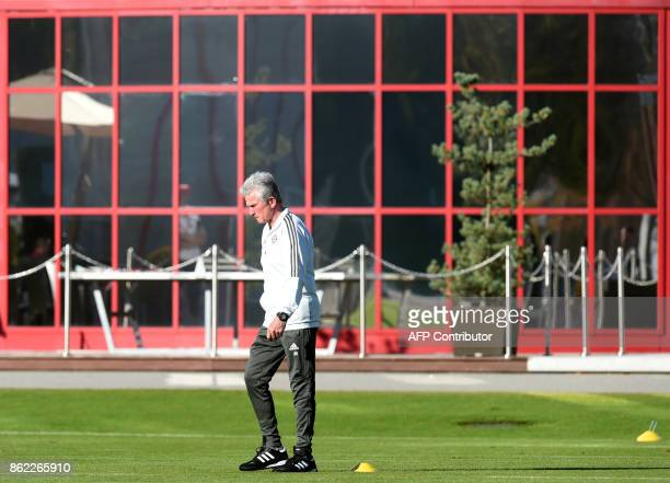 Bayern Munich's headcoach Jupp Heynckes walks on the pitch during a training session on the eve of the Champions League group B match between Bayern...
