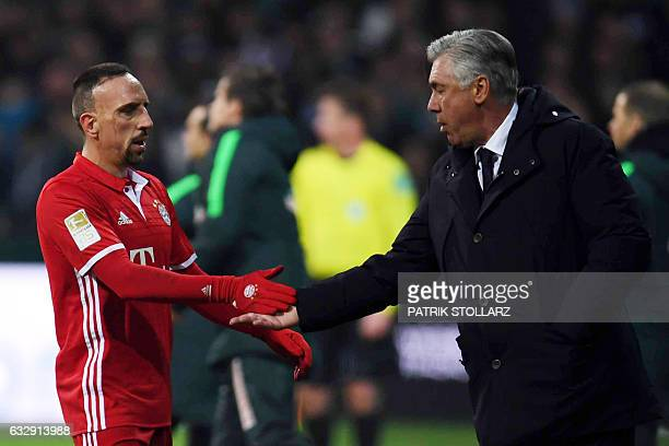 Bayern Munich's Italian head coach Carlo Ancelotti and Bayern Munich's French midfielder Franck Ribery shake hands during the German first division...