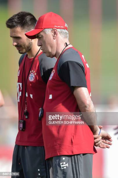 Bayern Munich's Italian head coach Carlo Ancelotti and his son Bayern Munich's assistant coach Davide Ancelotti are pictured during a training of the...