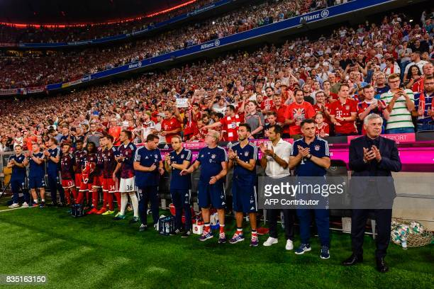 Bayern Munich's Italian head coach Carlo Ancelotti and his team applaud prior to the German First division Bundesliga football match FC Bayern Munich...