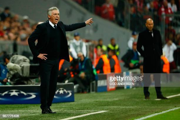 Bayern Munich's Italian head coach Carlo Ancelotti and Real Madrid's French coach Zinedine Zidane follow the action during the UEFA Champions League...