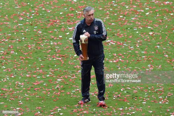 Bayern Munich's Italian head coach Carlo Ancelotti celebrates after the German first division Bundesliga football match FC Bayern Munich vs SC...