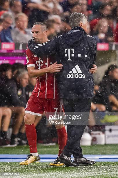 Bayern Munich's Italian head coach Carlo Ancelotti hugs Bayern Munich's French midfielder Franck Ribery during the German first division Bundesliga...