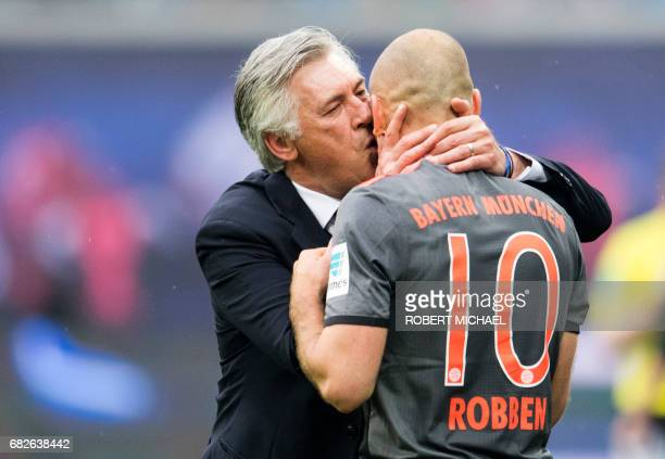 Bayern Munich's Italian head coach Carlo Ancelotti kisses Bayern Munich's Dutch midfielder Arjen Robben as he scored the 45 during extra time of the...