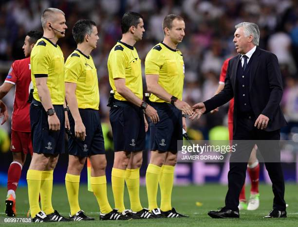 Bayern Munich's Italian head coach Carlo Ancelotti shakes hands with referees at the end of the UEFA Champions League quarterfinal second leg...