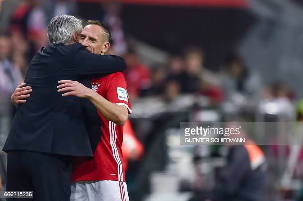 Bayern Munich's Italian head coach Carlo Ancelotti thanks Bayern Munich's French midfielder Franck Ribery during the German first division Bundesliga...