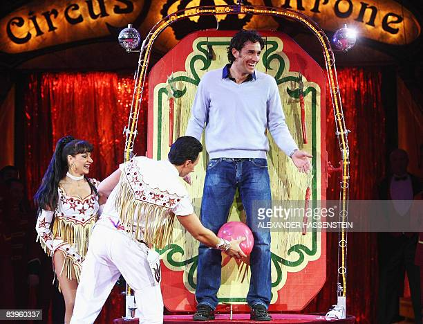 Bayern Munich's Italian striker Luca Toni jokes after a knife thrower performed with him during the FC Bayern Circus Gala at the Circus Krone on...