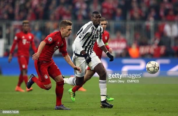 Bayern Munich's Joshua Kimmich and Juventus' Paul Pogba battle for the ball